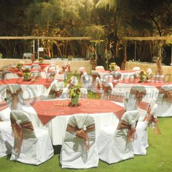 Elegant round party table with centerpiece flower decoration for wedding and other events
